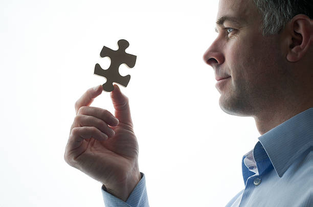 Last piece of the puzzle stock photo