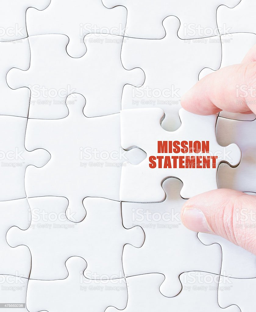 Last puzzle piece with words MISSION STATEMENT stock photo