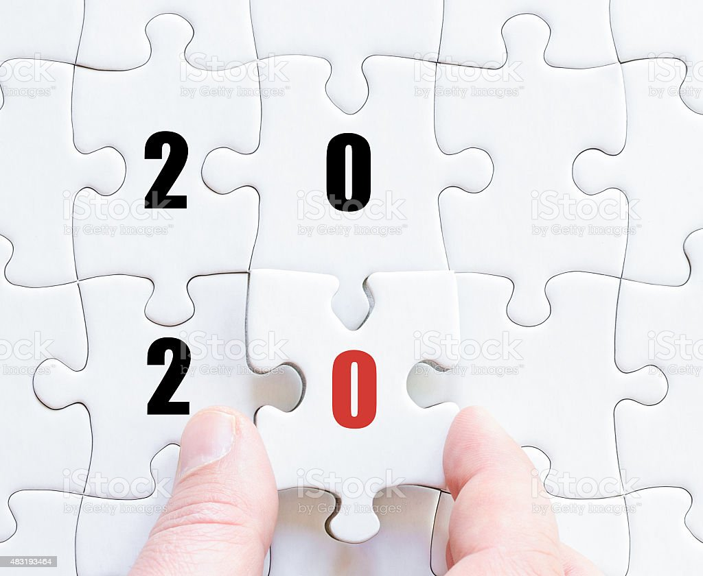 Last puzzle piece with year 2020 stock photo