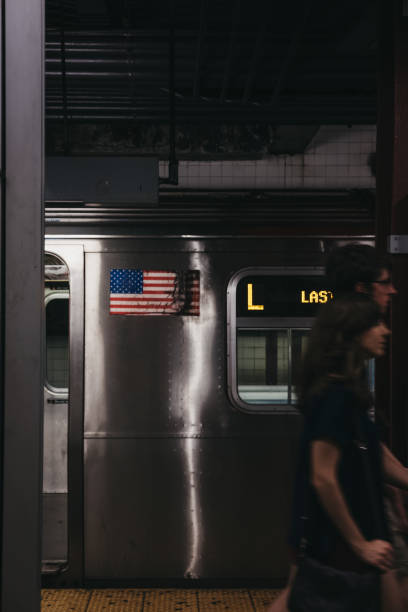 new york, usa - june 2,  2018: last stop announcement on l line train in new york, usa, people walking past, motion blur. new york city subway is one of the world's oldest public transit systems. - stop motion stock photos and pictures