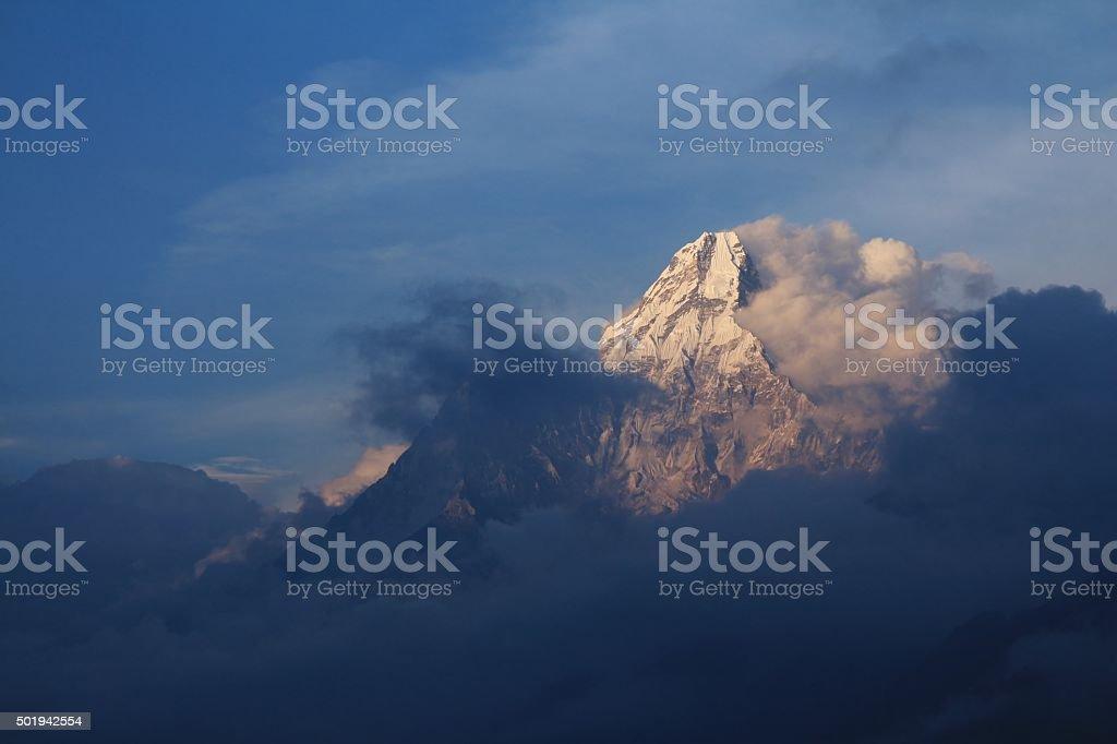 Last sunlight illuminating Mt Ama Dablam stock photo