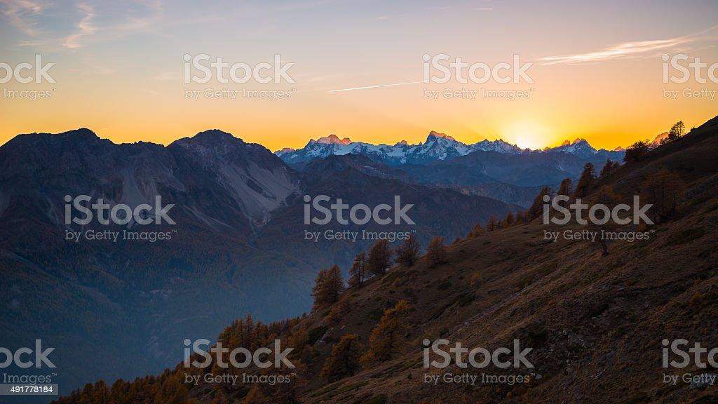 Last sunlight on majestic mountain peak stock photo