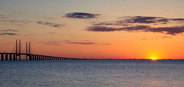 Last sunshine near the bridge stock photo