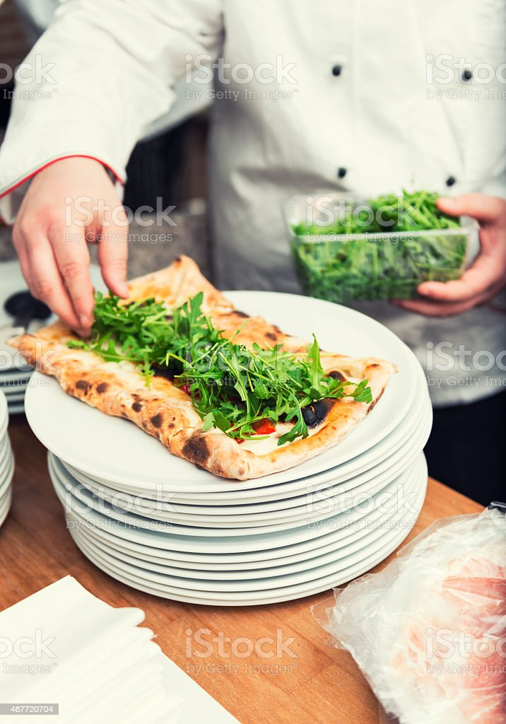 Last touch of the pizza chef stock photo