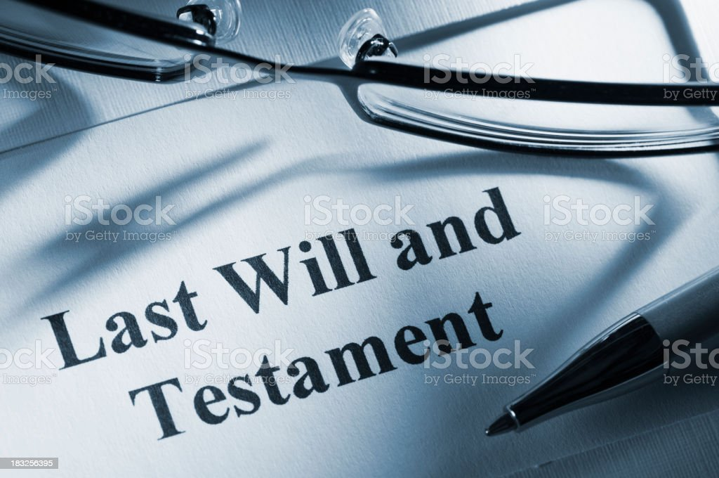Last will and testament paperwork with glasses and pen royalty-free stock photo