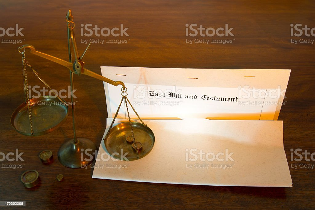 Last Will and Testament with Legal Scales stock photo