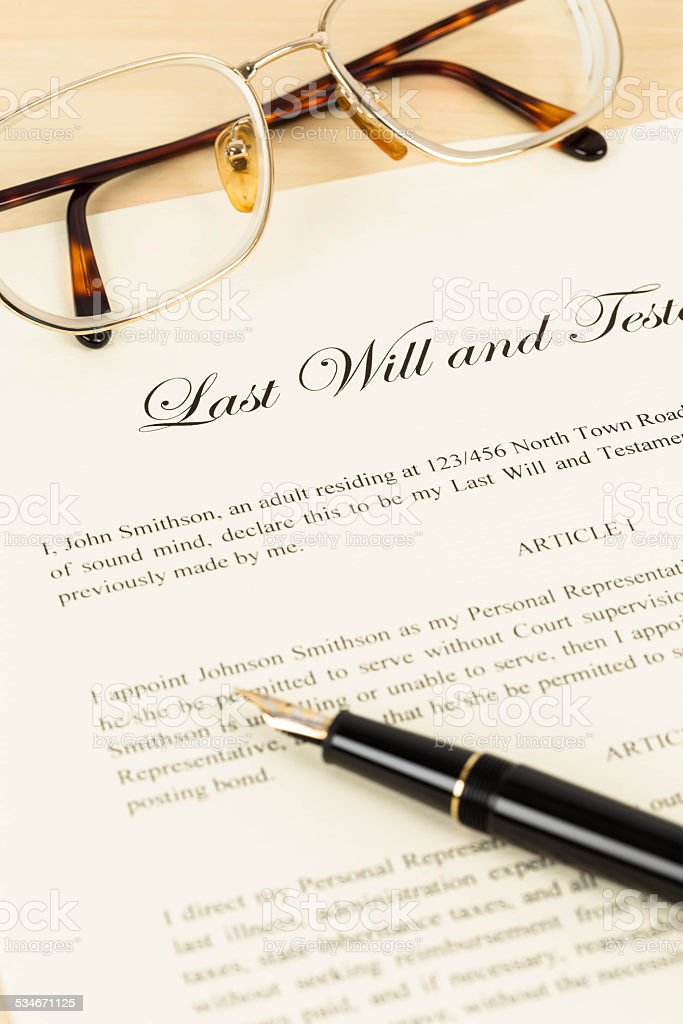 Last will on cream color paper with glasses and pen stock photo