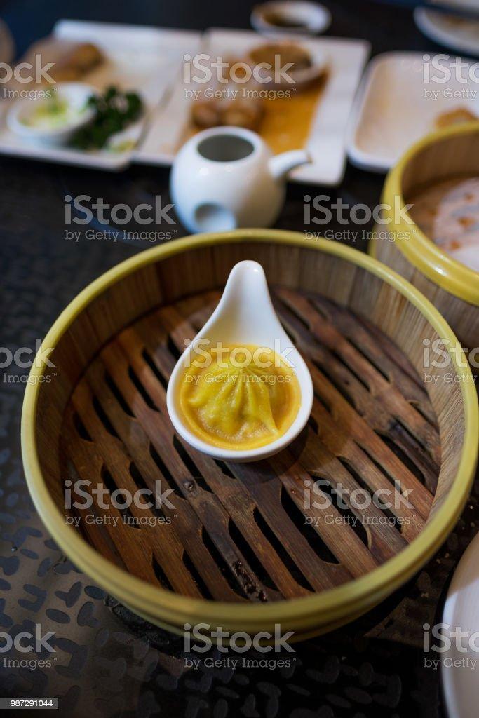 Last Xiao Long Bao - xlb - dimsum - in serving dish stock photo