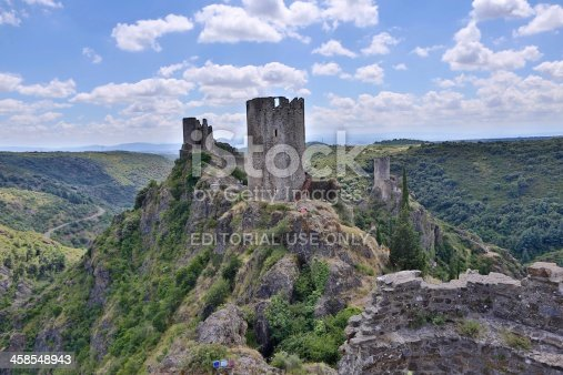 Lastours, France - August 9, 2013: Tourists are visiting the ruins of the castles of Lastours in the Aude department in southern France.