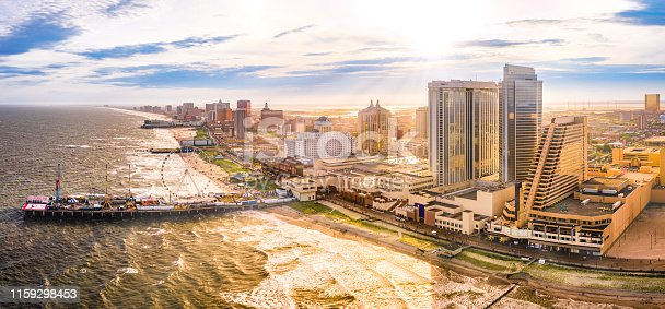 Late afternoon aerial panorama of Atlantic city along the boardwalk. Atlantic City achieved nationwide attention as a gambling resort and currently has nine large casinos.