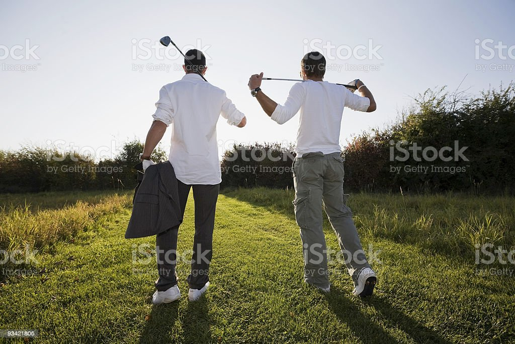 Late Afternoon Golf Players stock photo