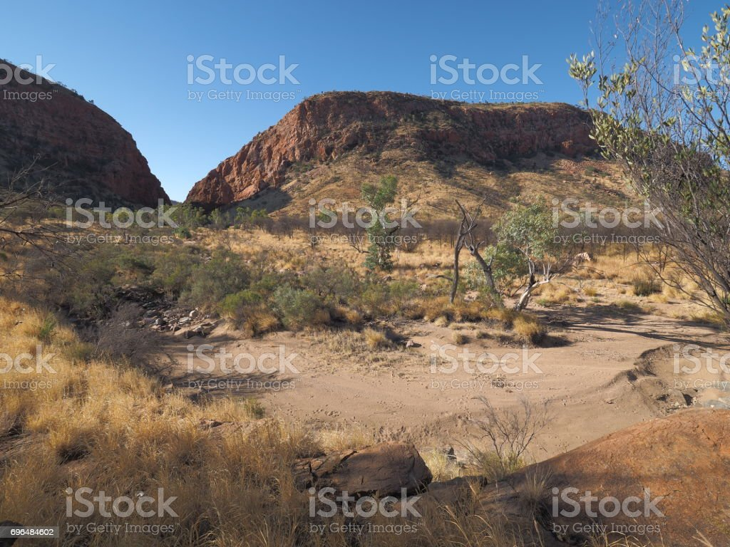 Late afternoon outback in the dry river bed at Simpsons Gap the McDonnell Ranges near Alice Springs, Australia, May 2017 stock photo