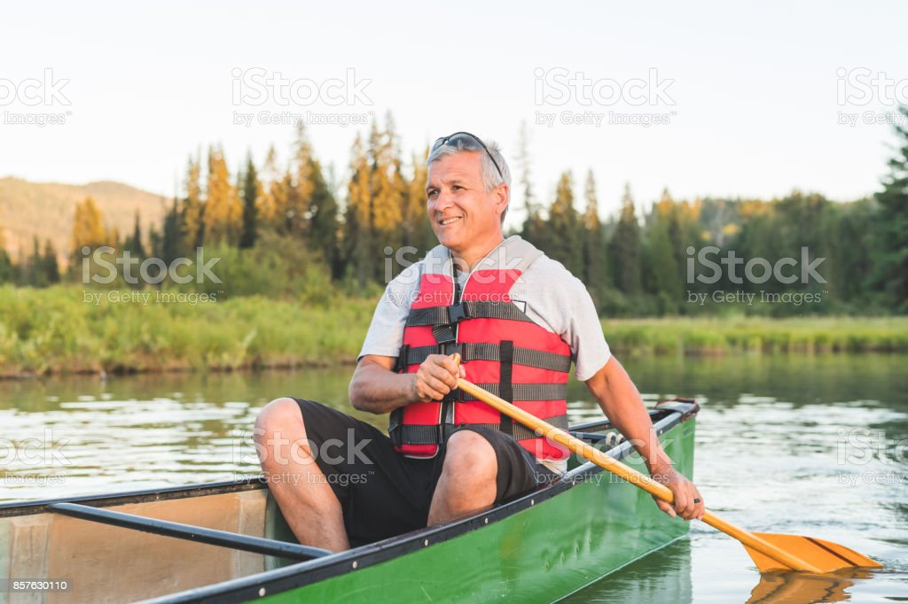 Late Afternoon Solo Canoe Trip Stock Photo - Download Image