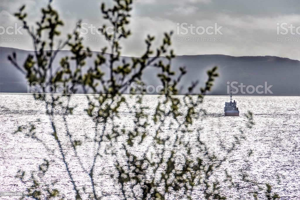 Late Afternoon Spring Sunshine on the Harbour at Uig, Isle of Skye, Scotland stock photo