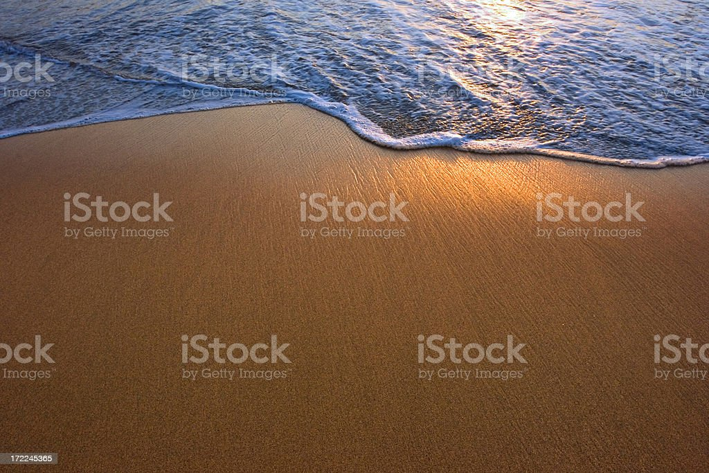 Late afternoon sun reflecting off of a gentle surf royalty-free stock photo
