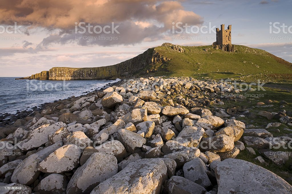 Late Afternoon Sunshine Illuminates Dunstanburgh Castle stock photo