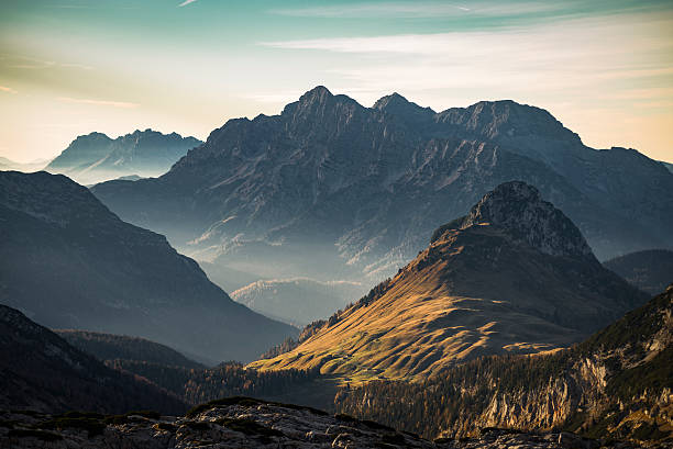 late autumn sunset on alpine pastures and mountains in austria - dağ stok fotoğraflar ve resimler