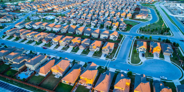 Late Dusk Sunset on Modern Suburban Neighborhood Community North Austin Texas The Suburbs Aerial Drone View above Modern Development Suburbia , Rows after Rows , Thousands of Homes and Rooftops , Afternoon Sunset on Modern Suburban Neighborhood Community North Austin Texas The Suburbs urban sprawl stock pictures, royalty-free photos & images