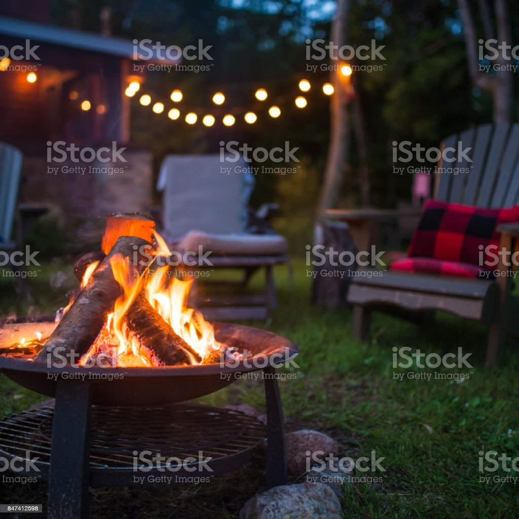 Late evening campfire at a beatiful canadian chalet stock photo