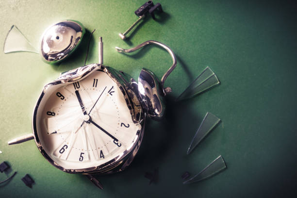late for school concept with alram clock on a blackboard stock photo