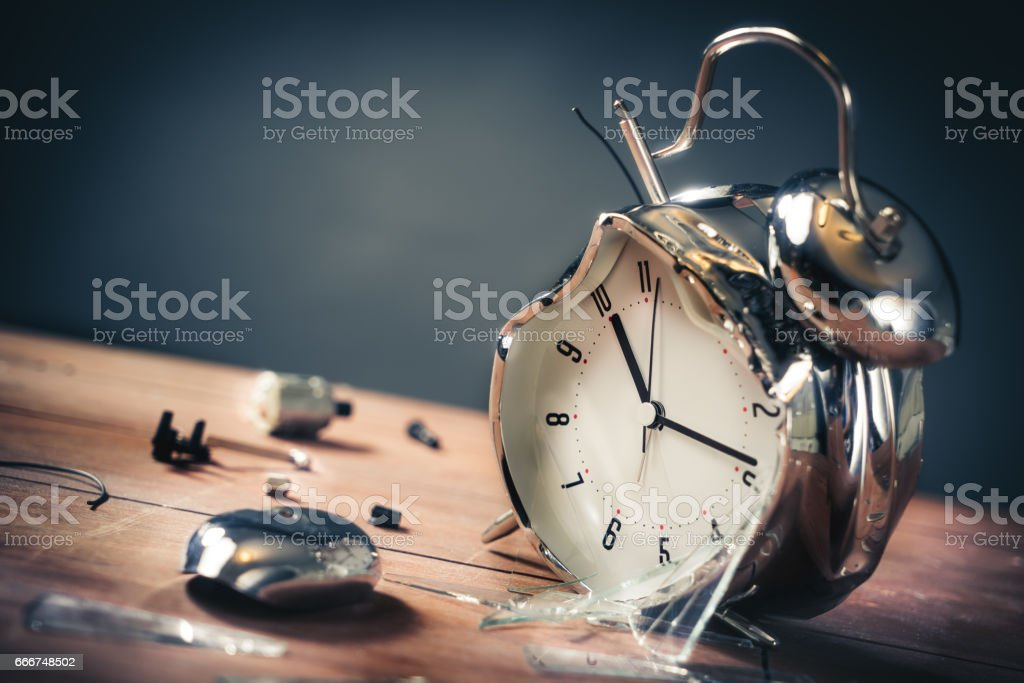 late for work concept with destroyed alarm clock foto stock royalty-free
