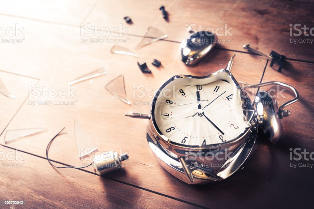 late for work concept with destroyed alarm clock stock photo