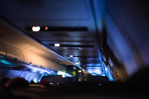 late-night flight - rot bekümmerte möbel stock-fotos und bilder