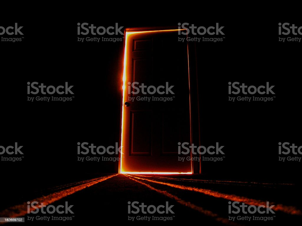 Late night image of a slightly open door stock photo
