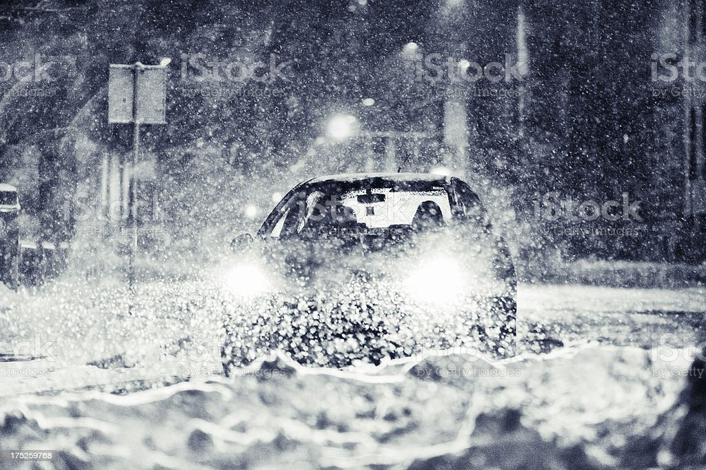 Late night traffic on a severe snow storm royalty-free stock photo