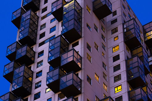 Late night view of council flats. Exterior of complex building in the city