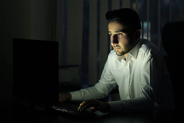 late night working on computer - low lighting stock photos and pictures