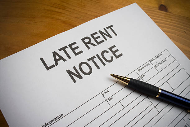 Late rent notice paperwork with pen stock photo