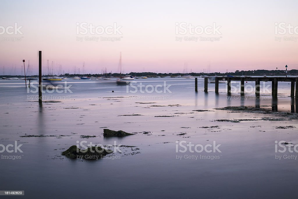 Late Summer evening landscape across harbor with jetty royalty-free stock photo