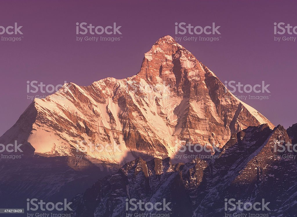 Late sunset scene over mountain 'Nanda devi' royalty-free stock photo