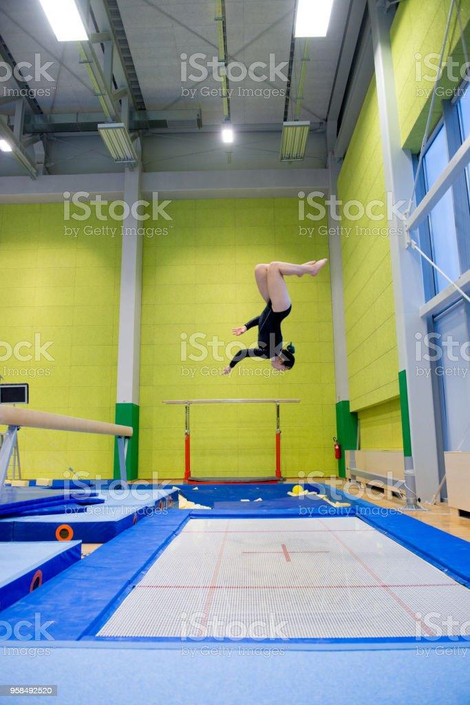 Late Teen Athlete Enjoying Trampoline Training stock photo