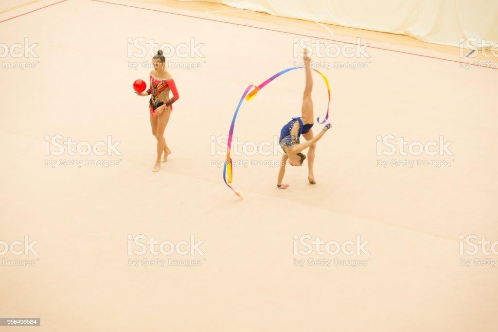 Rhythmic Gymnastics Coach Guiding Athlete Practicing with Ribbon.