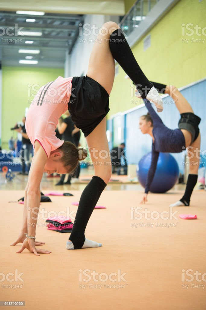 Late Teen Rhythmic Gymnastics Athletes Warming Up.