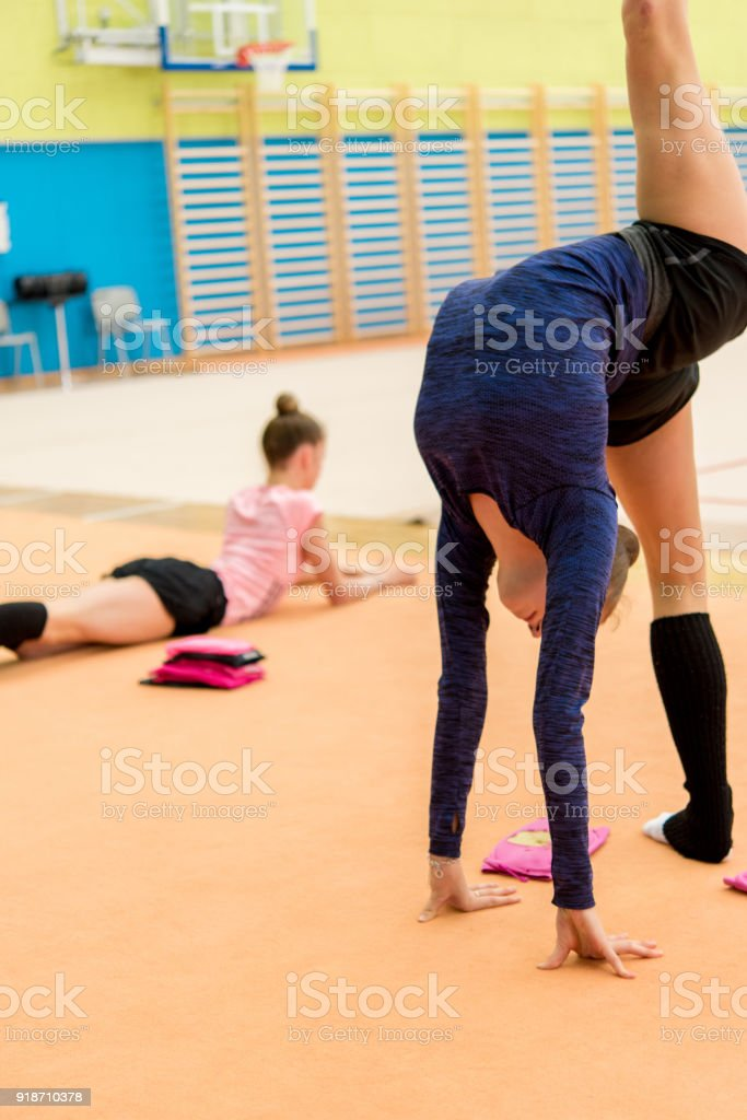 Warm-Up of Teen Rhythmic Gymnasts - a Royalty Free Stock