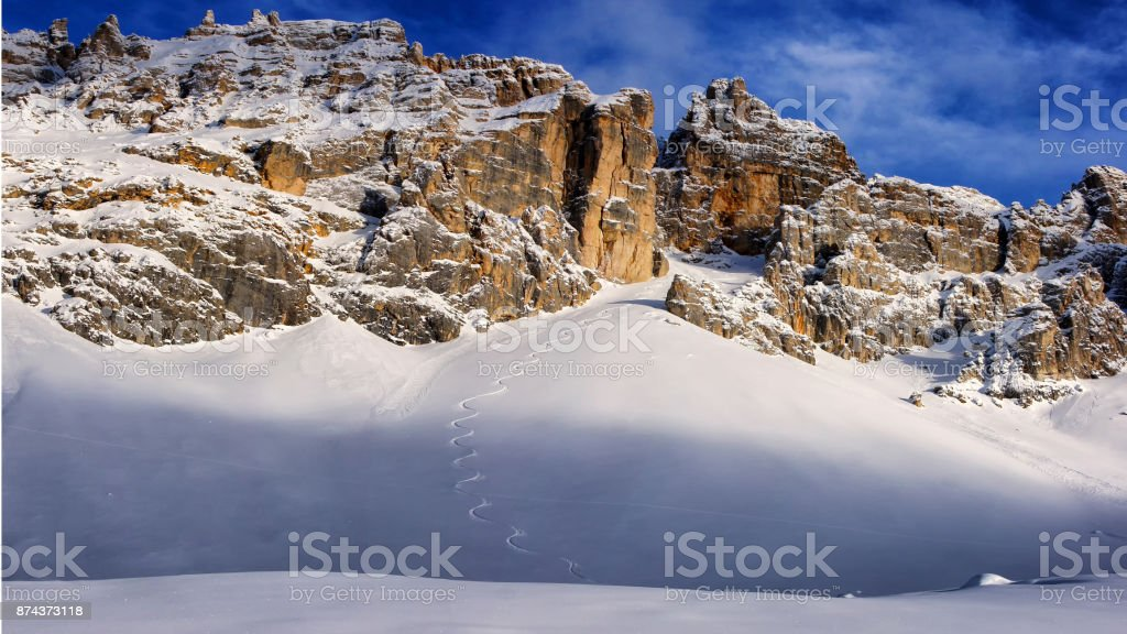 Latemar winter panorama with freeride ski track in the middle of fresh snow stock photo