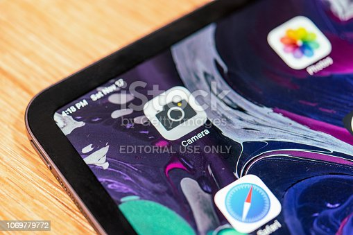 istock Latest Apple iPad Pro release, on a wooden bench in a store 1069779772