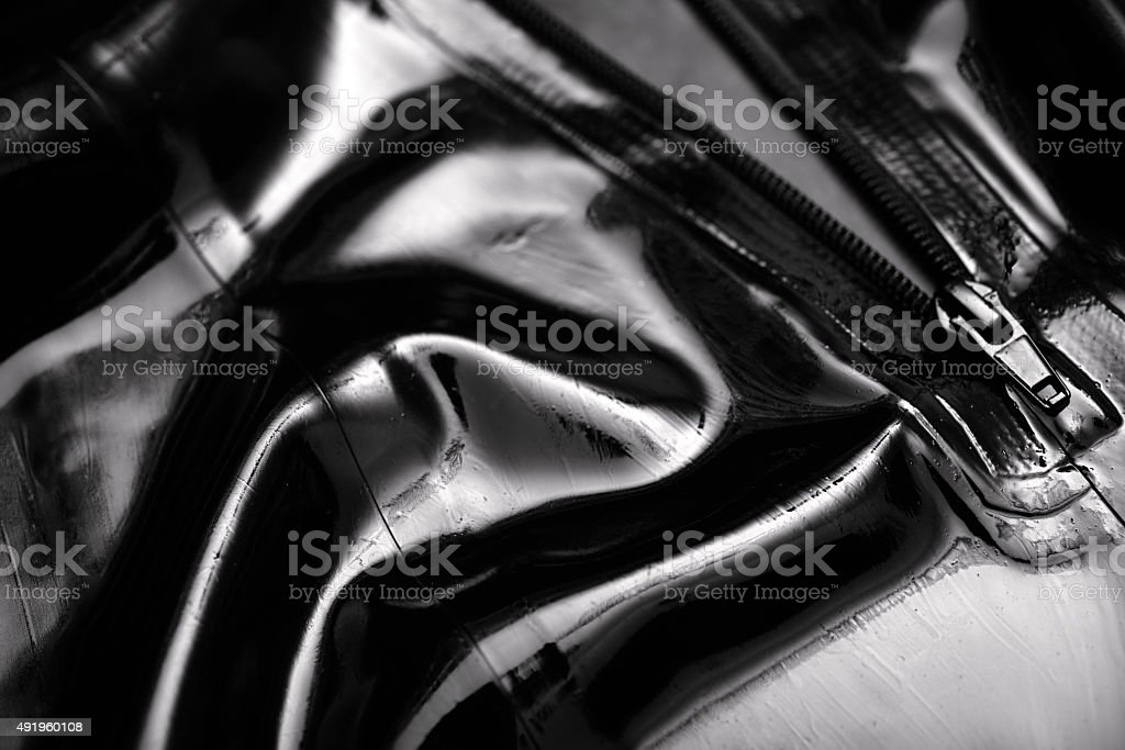 latex abstract pants with zipper, macro stock photo