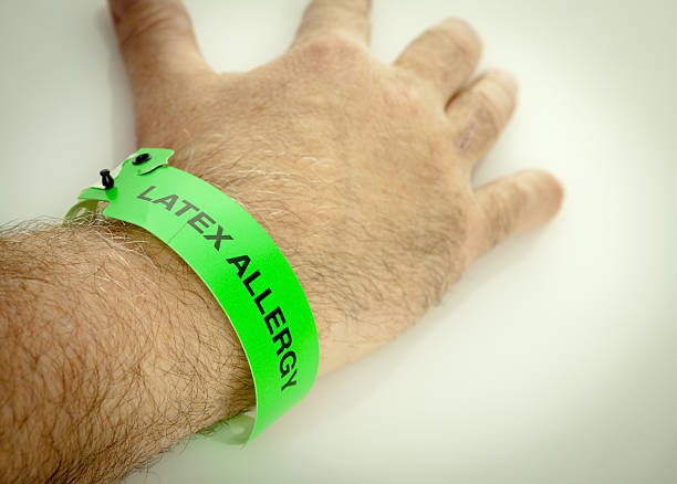 latex allergy wrist bracelet - latex stock pictures, royalty-free photos & images