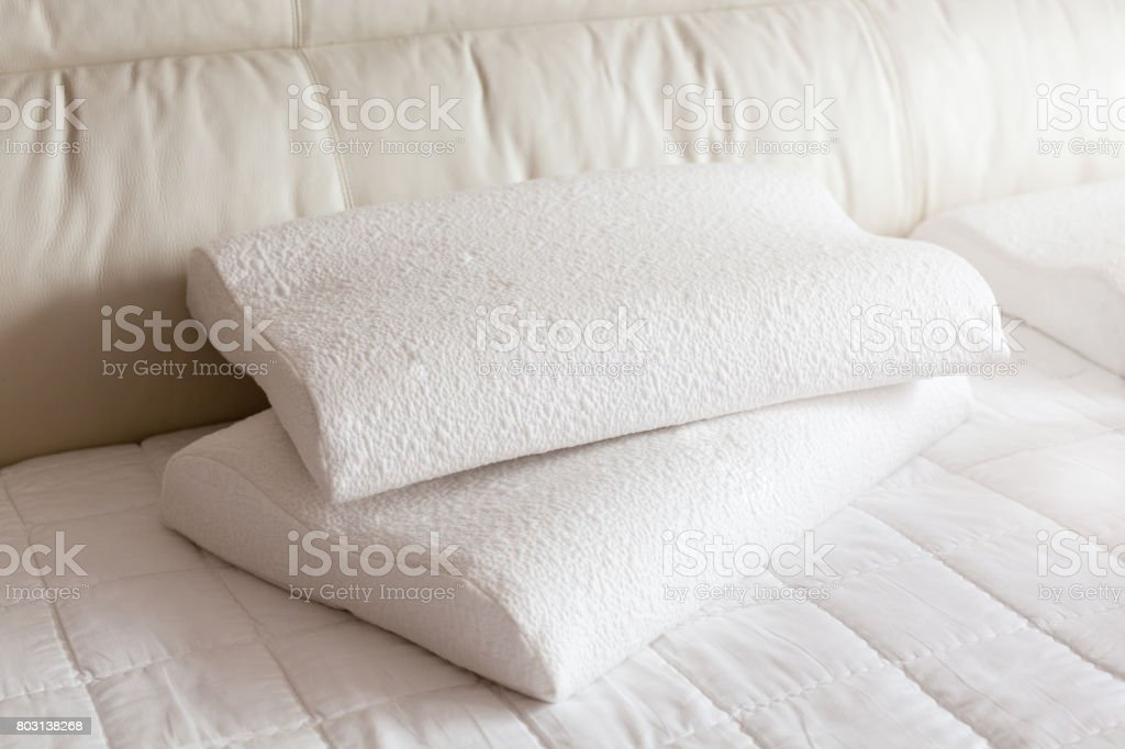 latex pillow on bed in sunshine stock photo
