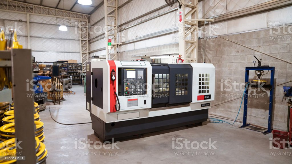 Lathe machine in metal industry Lathe machine in industry. Manufacturing machinery is in factory. Absence Stock Photo
