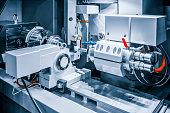 CNC lathe machine or Turning machine chucking the steel cone shape rod. Hi technology manufacturing process.