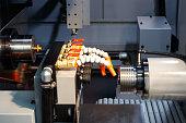 CNC lathe machine or Turning machine chucking the steel cone shape rod .Hi technology manufacturing process.