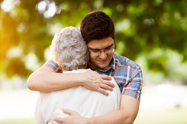 Latin adult man consoling his grandmother – Foto