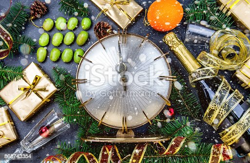istock NEW YEAR TRADITION. Latin American and Spanish New Year traditional. Funny ritual to eat twelve 12 grapes for good luck at midnigth. Flat lay, top view. Christmas New Year composition. 868743354