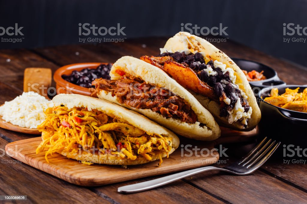 Latin American breakfast, Arepas with several ingredients. stock photo