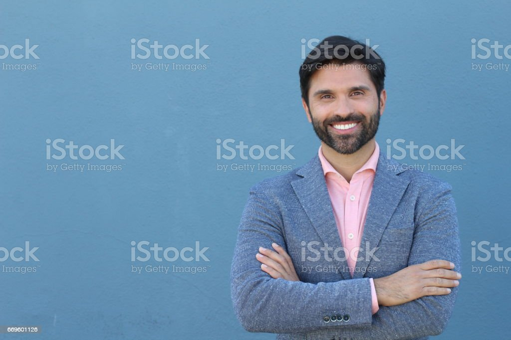 Latin American business man isolated on blue background stock photo